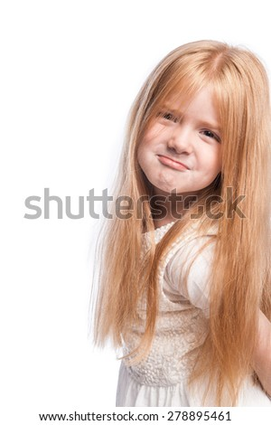 Silly face with lots of hair on young girl in studio shot on white background. - stock photo