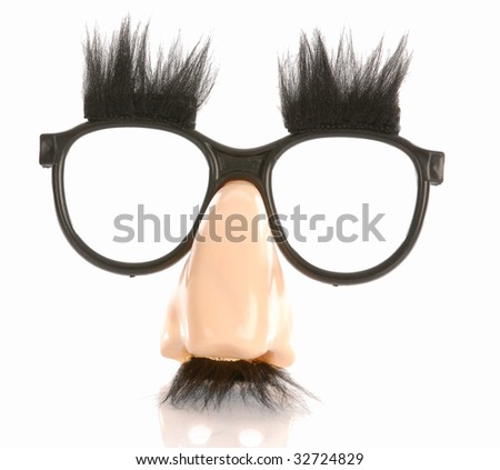 silly groucho marx style glasses isolated on white - stock photo