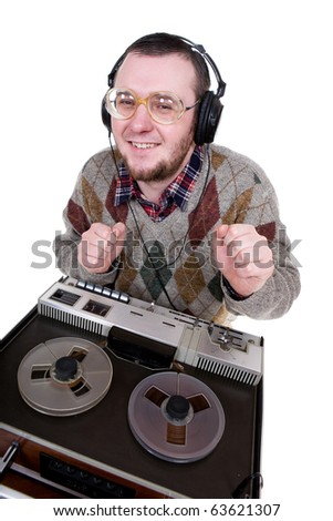 silly man enjoying music. over white background - stock photo