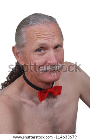 Silly middle aged man wearing only a red bowtie. Isolated on black - stock photo