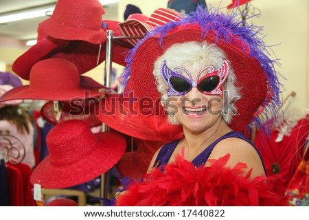 Silly senior society woman wearing butterfly glasses - stock photo