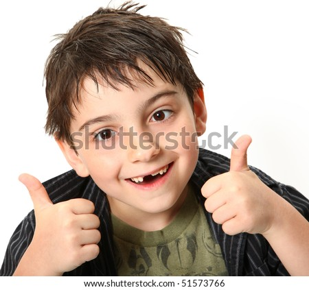 Silly seven year old boy making crossed eyes and thumbs up gesture. - stock photo