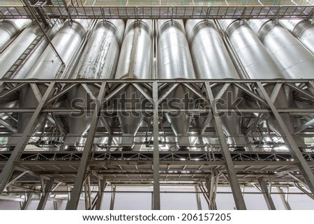 Silo in Ricemill process production line - stock photo