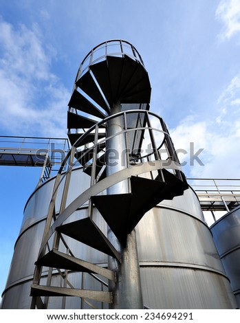 Silos and steel machinery for the processing of the grapes. - stock photo