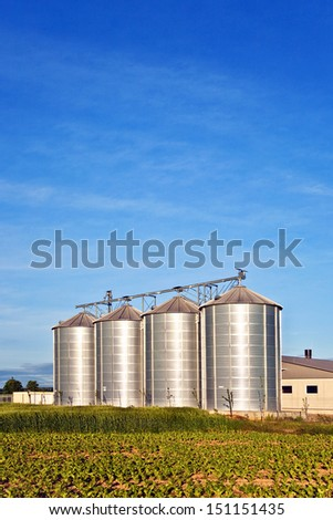 silos in beautiful landscape and acres - stock photo