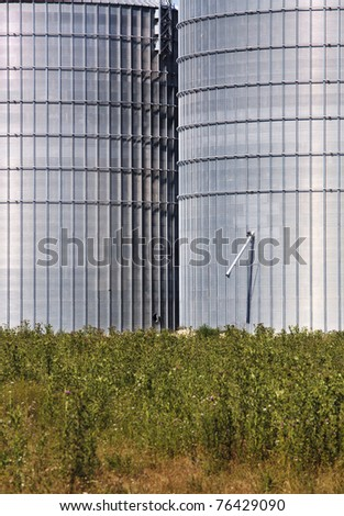 silos in green landscape and acres