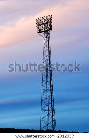 Silouette of floodlights against colourfull clouds