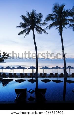 Siluette of a beautiful sunrise on the beach - stock photo