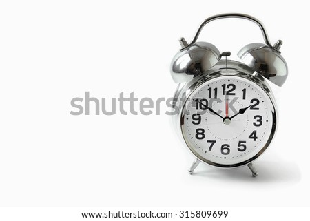 Silver alarm clock on white background