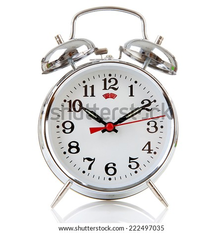 Silver alarm clock over white background