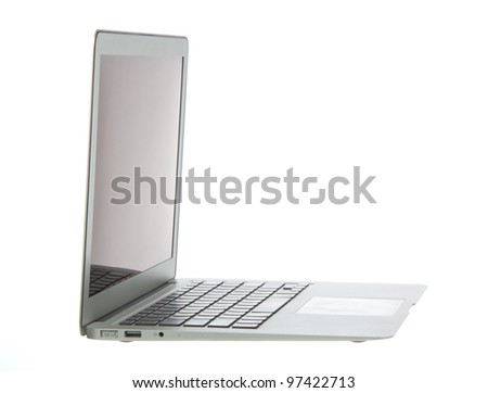 Silver aluminum laptop computer notebook side with touchpad, keyboard and open slots isolated on a white background - stock photo