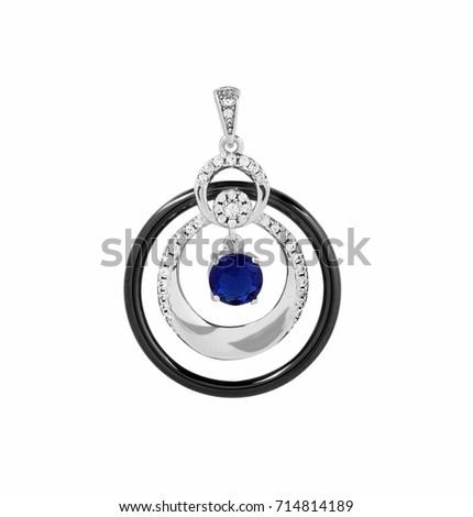 Silver and black jewellery pendant with blue gem isolated on white background