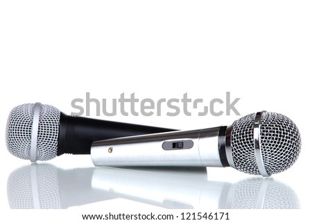 Silver and black microphones isolated on white