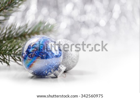 Silver and Blue Christmas ornaments on glitter bokeh background with space for text. Xmas and Happy New Year theme - stock photo