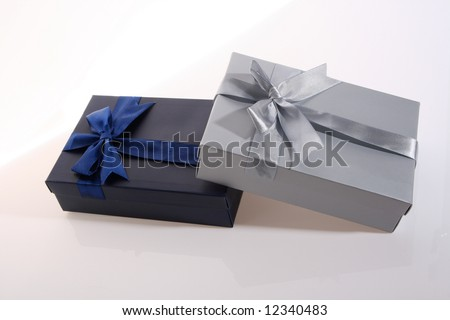 silver  and   blue    color      gift     box  with  beautiful  ribbon