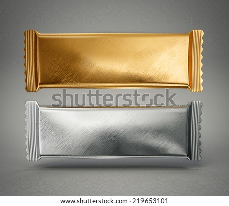 silver and gold package isolated on a grey background - stock photo