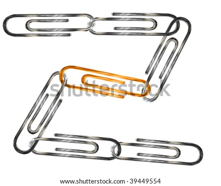 silver and golden paper clips isolated over white background - stock photo