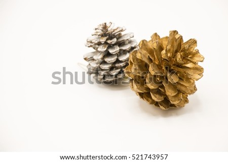 silver golden pine cone on white stock photo royalty free