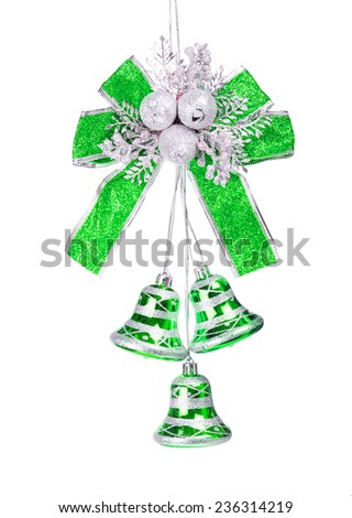 Silver and green bells with a blue bow isolated on white - stock photo