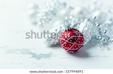 Silver and red Christmas ornaments - stock photo