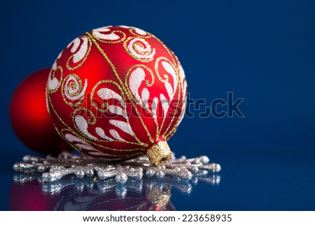 Silver and red christmas ornaments on dark blue background with space for text. Merry christmas card. Winter holidays. Xmas. - stock photo
