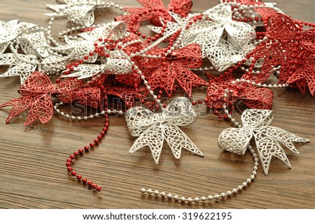 Silver and Red ribbon garland to decorate a Christmas tree - stock photo
