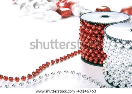 Silver and red xmas garland and balls isolated on white