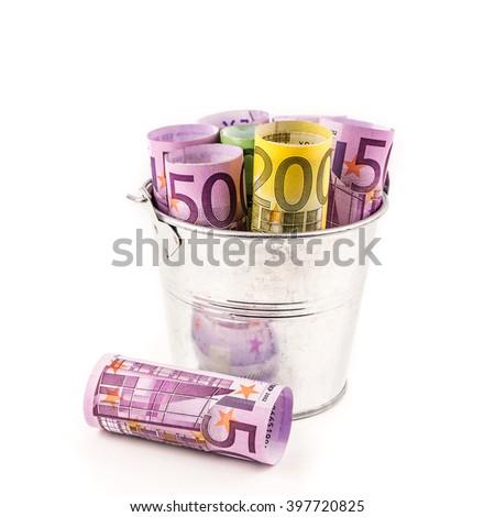 silver basket full of big euro banknotes on white background - stock photo