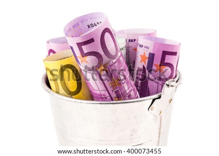 silver basket full of big euro banknotes on white background