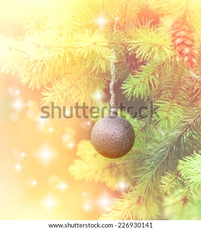 Silver bauble on branch of Christmas tree - stock photo