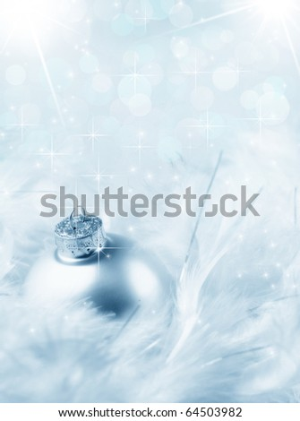 Silver bauble snowy white feather - cold winter blue toning, sparkling bokeh background - stock photo