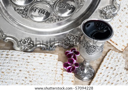 silver beaker with red wine and matzot - stock photo