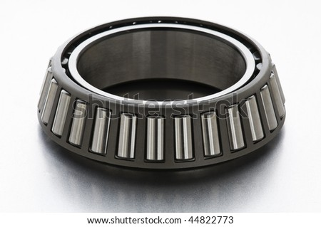 Silver bearing on metal surface close up shoot - stock photo