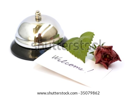 silver bell and welcome inscription isolated on white - stock photo