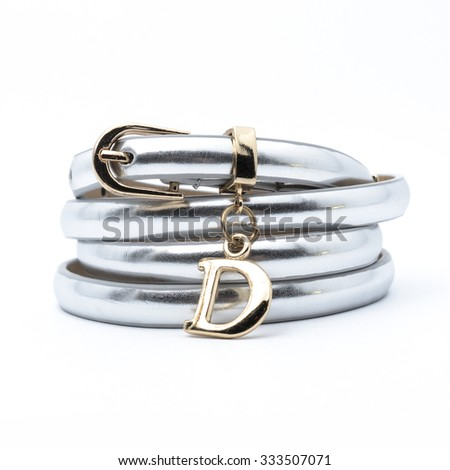 silver belt with the letter d isolated on white - stock photo