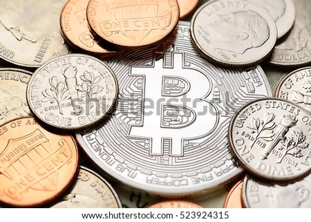Silver Bitcoin with different US coins: penny, dime, quarter