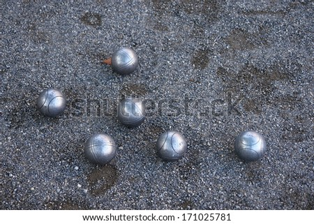 silver boccia ball on the ground - stock photo