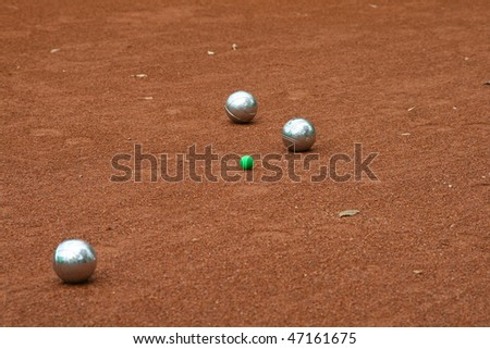 Silver boccia balls on the ground - stock photo