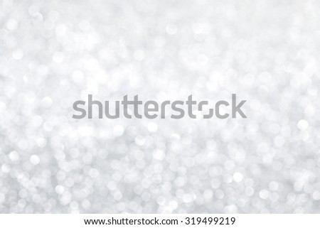 Silver bokeh abstract light holiday background - stock photo