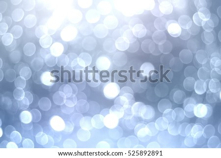 Silver bokeh festive background. Sparkling Christmas lights texture.