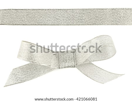 Silver bow and ribbon isolated on white - stock photo