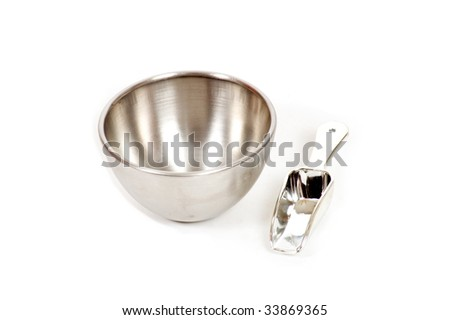 silver bowl with measuring scoop isolated on white