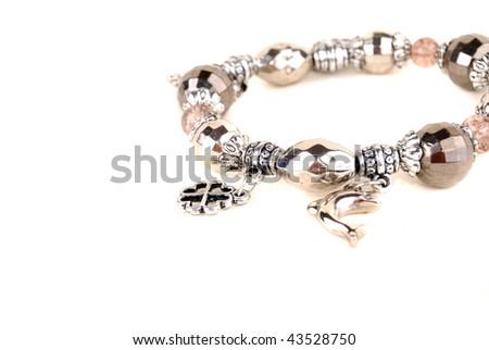 Silver bracelet isolated on white. Zodiac signs - stock photo