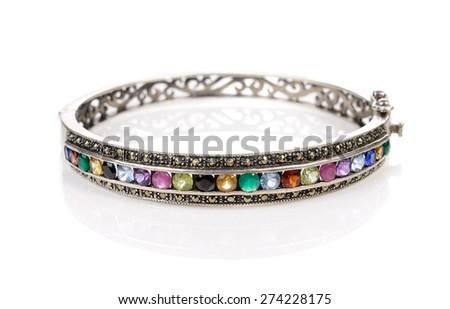 Silver bracelet with stone (pebble) on white - stock photo