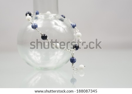 Silver bracelet with with lapis lazuli, jade and sodalite gemstones on white background