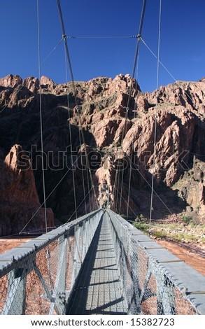 Silver bridge over colorado river in grand canyon - stock photo