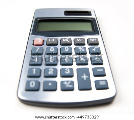 Silver calculator with empty screen on white background. Shallow depth of field.