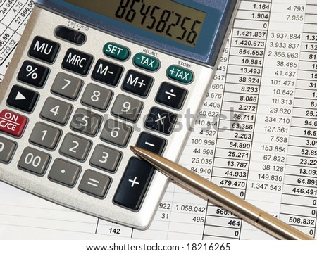 silver calculator with pen and calculations numbers on paper - stock photo