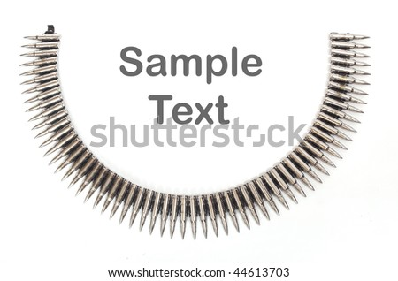 Silver chain of powerful cartridges, fashion accessory for rock musicians. - stock photo