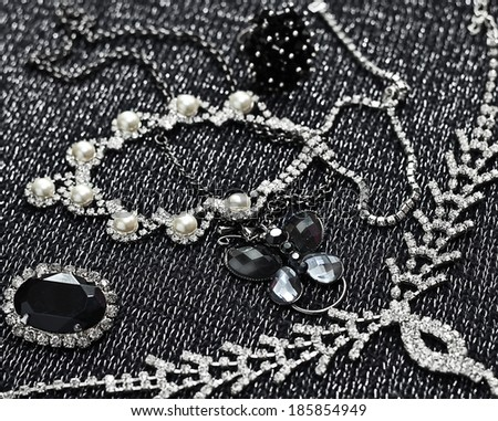 Silver chains, bracelets, pearl and necklaces  - stock photo